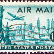 Stock Photo: USA - CIRCA 1947: A stamp printed in USA shows statue of Liberty, New York city and a Lockheed Constellation airplane, circa 1947.
