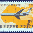 "HUNGARY - CIRCA 1977: A stamp printed in Hungary from the ""Planes, Airlines and Maps"" issue shows a Ilyushin IL-62, CSA, and North Africa map, circa 1977. — Stock Photo"
