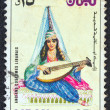 "LEBANON - CIRCA 1973: A stamp printed in Lebanon from the ""Ancient costumes"" issue shows a girl with a lute, circa 1973. — Stock Photo"