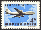 "HUNGARY - CIRCA 1977: A stamp printed in Hungary from the ""Planes, Airlines and Maps"" issue shows a Boeing 747, Pan Am and North America map, circa 1977. — Stock Photo"