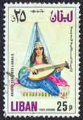 """LEBANON - CIRCA 1973: A stamp printed in Lebanon from the """"Ancient costumes"""" issue shows a girl with a lute, circa 1973. — Stock Photo"""