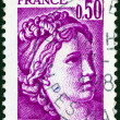 "FRANCE - CIRCA 1977: A stamp printed in France shows Sabine from the ""the kidnapping of the Sabines"" painting by Jacques-Louis David, circa 1977. — Stock Photo"