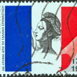 Stock Photo: GREECE - CIRC1989: stamp printed in Greece issued for bicentenary of French revolution, shows French flag and Liberty, circ1989.