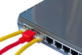 Network switch and ethernet cables — Stock Photo