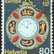 "SWITZERLAND - CIRCA 1976: A stamp printed in Switzerland from the ""Europa"" issue shows a decorated pocket watch from 1890, circa 1976. — Stock Photo"