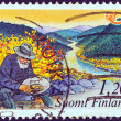 "FINLAND - CIRCA 1983: A stamp printed in Finland from the ""Nordic countries postal co-operation. Visit the north"" issue shows a gold prospector, circa 1983. — Stock Photo"