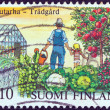 "FINLAND - CIRCA 1982: A stamp printed in Finland from the ""Centenary of first Finnish horticultural society"" issue shows a man and a little girl in a vegetable and fruit garden, circa 1982. — Stock Photo"