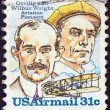USA - CIRCA 1978: A stamp printed in USA issued for the 75th Anniversary of First Powered Flight shows Wright brothers and Wright Flyer I plane, circa 1978. — Stock Photo