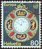 """SWITZERLAND - CIRCA 1976: A stamp printed in Switzerland from the """"Europa"""" issue shows a decorated pocket watch from 1890, circa 1976. — Stock Photo"""