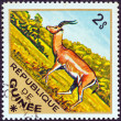 "GUINEA - CIRCA 1975: A stamp printed in Guinea from the ""Wild Animals"" issue shows a Impala (Aepyceros melampus), circa 1975. — Stock Photo"