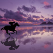 Silhouette of Horse & Rider on a beach at sunset — Stock Photo