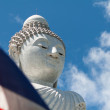 Thai flag covers buddha stone sculpture — Stock Photo
