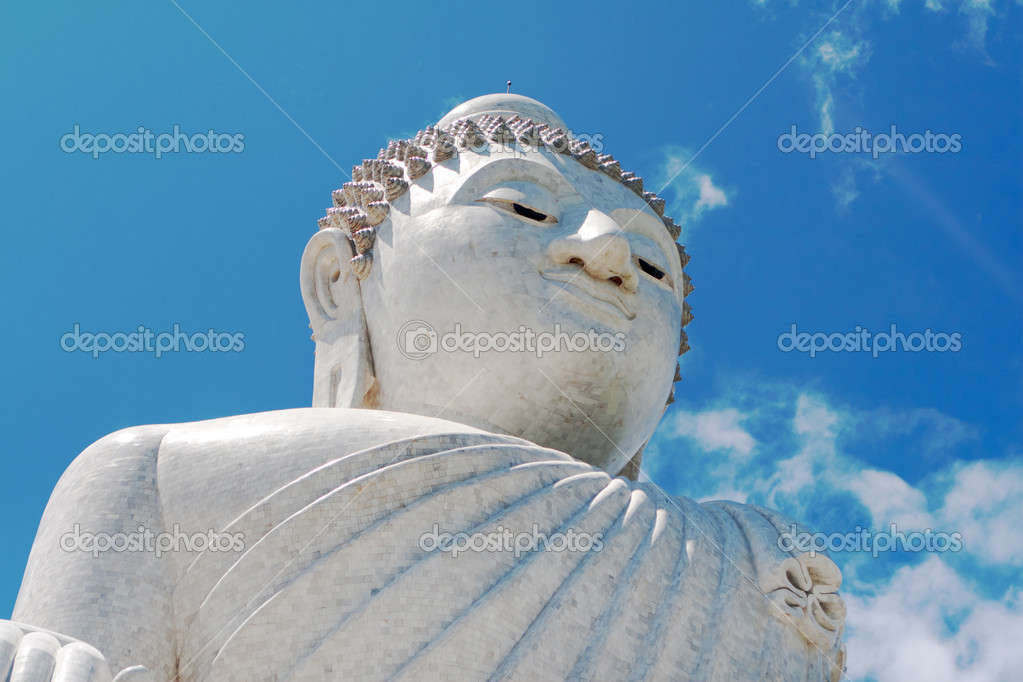 Buddha stone sculpture over the blue sky background — Stock Photo #11643297
