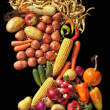Eatable portrait composed of fruits and vegetables in Giuseppe Arcimboldo style on black background — Stock Photo