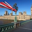 Big Ben with colorful flag of England in London — Stock Photo #10799177