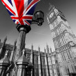 Big Ben with colorful flag of England in London — Stock Photo #10799281