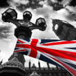 Big Ben with colorful flag of England in London — Stock Photo #10799829