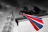 Big Ben with colorful flag of England in London — Stock Photo