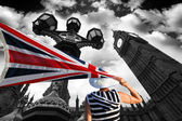 Big Ben with woman holding a flag of United Kingdom in London — Stock Photo