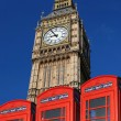 Big Ben with phone boxes, London, UK - Stock Photo