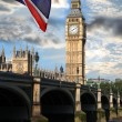 Big Ben with colorful flag of England in London — Stock Photo #10801945