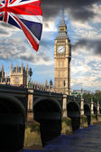Big Ben with colorful flag of England in London — Photo