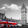 Big Ben with city bus covered flag of England, London, UK - Stock Photo