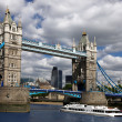 Tower Bridge with boat, London, UK - Stock Photo