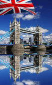 London Tower Bridge with colorful flag of England — Stock Photo