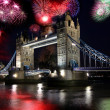Tower bridge with firework, celebration of New Year in London, UK — Stock Photo #11037545