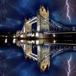 Tower Bridge with lightnings at stormy night in London, UK — Stock Photo