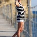Sexy Woman in summer resort near the sea — Stock Photo #11107971