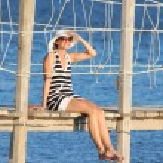 Sexy Woman on the bridge above sea — Stock Photo #11108336