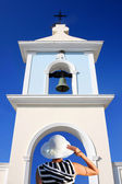 Traditional Greek church-bell with woman with white hat — Foto Stock