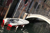 Venice with alone boat on canal in Italy — Stock Photo