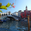 Venice, Ponte Rialto bridge with gondola  — Stock Photo