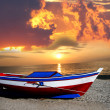Fishing boat against beautiful sunset — Stock Photo
