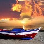 Fishing boat against beautiful sunset — Stock Photo #11150557