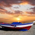 Fishing boat against beautiful sunset — Stock Photo #11150601