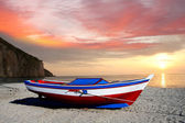 Fishing boat against beautiful sunset — Stock Photo