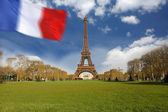 Eiffel Tower with flag in Paris, France — Stock Photo
