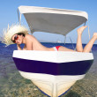 Sexy young Woman relaxing on motor boat against azure sea — Stock Photo #11169655