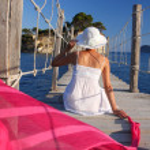 Sexy Woman on wooden bridge above sea — Stock Photo