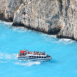 Greek coast with tourist boat — Stock Photo #11170649