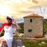 Woman with Greek windmill, Zakynthos Island — Stock Photo #11170839