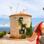 Woman with Greek windmill, Zakynthos Island — Stock Photo #11264660