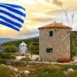 Traditional Wind Mill in Greece with greek flags — Stock Photo