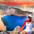 Navagio beach with woman on cliff — Stock Photo #11266135
