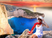 Navagio beach with woman on cliff — Stock Photo