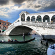 Ponte Rialto bridge with gondola — Stock Photo #11275042